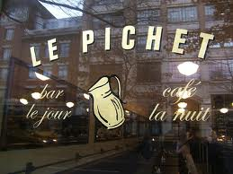 The front window of Le Pichet beckons curious passerbys. | Courtesy of seattleweekly.com